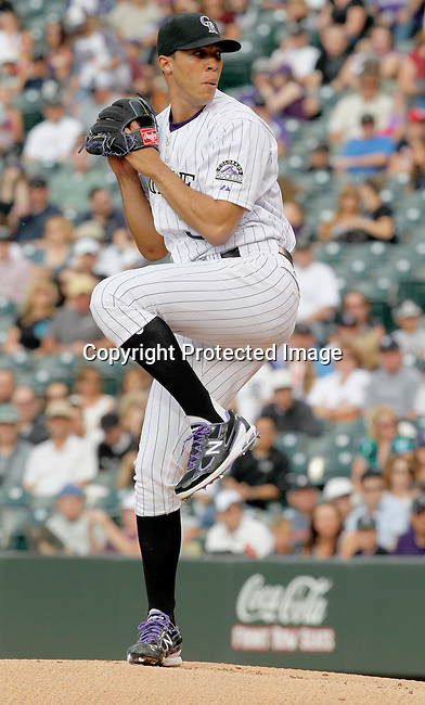 Colorado Rockies starting pitcher Ubaldo Jimenez (38) warms up prior to a game against the Detroit Tigers.  The Rockies defeated the Tigers 5-4 on June 19, 2011 at Coors Field in Denver, Colorado. (AP Photo/Margaret Bowles)