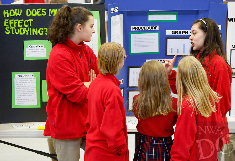 NWA Democrat-Gazette/DAVID GOTTSCHALK  Emily Lopshire (right) and Cheyenne Hillman (left) explain their sound related science projects Thursday, February 11, 2016, at the annual St. Joseph Catholic School Science Fair in Fayetteville. Students in the sixth through eighth grades created 68 projects in the fields of chemistry, behavioral science and engineering. The students are competing to advance to the Northwest Arkansas Regional Science and Engineering Fair on March 4 at the University of Arkansas.