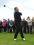 Members look on as new Captain Joseph O'Toole Tees off at the Captain's Drive In at Laytown & Bettystown Golf Club. Photo: Colin Bell/pressphotos.ie