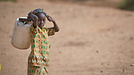 A girl carries water in Gidel, a village in the Nuba Mountains of Sudan.