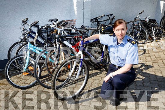 Garda Karen Sheehan with the more than a dozen stolen bikes that Killarney Gardai have recovered
