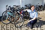 Garda Karen Sheehan with the more than a dozen stolen bikes that Killarney Gardai have recovered