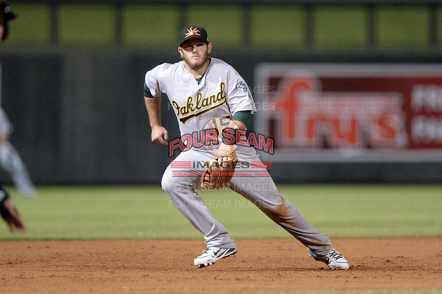 Mesa Solar Sox infielder Max Muncy (15), of the Oakland Athletics organization, during an Arizona Fall League game against the Salt River Rafters on October 10, 2013 at Salt River Fields at Talking Stick in Scottsdale, Arizona.  Mesa defeated Salt River 8-1.  (Mike Janes/Four Seam Images)