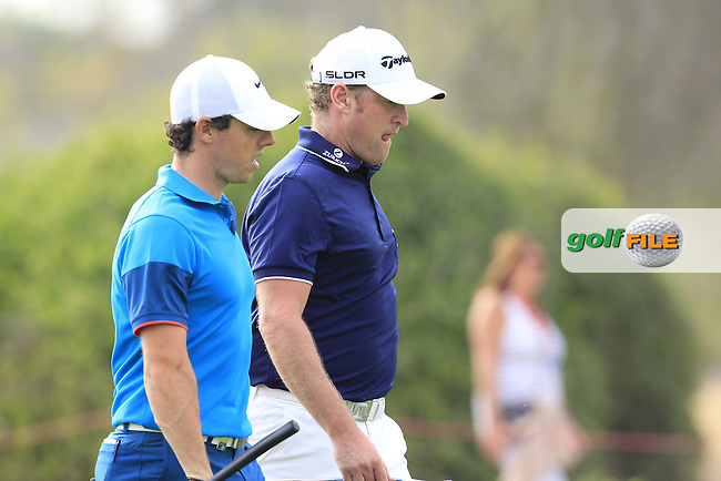 Rory McIlroy (NIR) and Jamie Donaldson (WAL) on the 13th hole during Sunday's Final Round of the Abu Dhabi HSBC Golf Championship 2015 held at the Abu Dhabi Golf Course, United Arab Emirates. 18th January 2015.<br /> Picture: Eoin Clarke www.golffile.ie