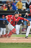 Lowell Spinners catcher Jordan Procyshen (34) retrieves a pitch in the dirt during a game against the Batavia Muckdogs on July 16, 2014 at Dwyer Stadium in Batavia, New York.  Lowell defeated Batavia 6-4.  (Mike Janes/Four Seam Images)