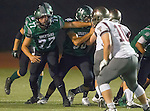 Torrance, CA 10/09/15 - Brice Vanness (South #77) and Daniel Desmond (Torrance #10) in action during the Torrance vs South High varsity football game.  South defeated Torrance 24-21.