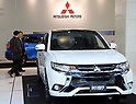October 18, 2017, Tokyo, Japan - Japan's automaker Mitsubishi Motors (MMC) displays the company's plug-in hybrod Outlander at the MMC headquarters in Tokyo on Wednesday, Octoebr 18, 2017. MMC announced its mid-term strategy and three-year plan would target more tha 30 percent increase in unit sales and revenues.    (Photo by Yoshio Tsunoda/AFLO) LWX -ytd-