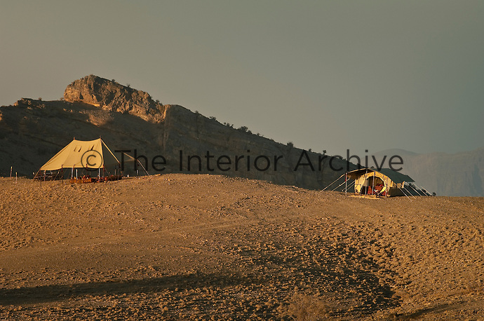 The camp's communal reception tent and one of the sleeping tents pitched on a mountain plateau