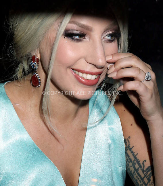 WWW.ACEPIXS.COM<br /> <br /> February 27 2015, New York City<br /> <br /> Singer Lady Gaga shows off her engagement ring as she leaves her Midtown Manhattan apartment on February 27 2015 in New York City<br /> <br /> By Line: Philip Vaughan/ACE Pictures<br /> <br /> ACE Pictures, Inc.<br /> tel: 646 769 0430<br /> Email: info@acepixs.com<br /> www.acepixs.com