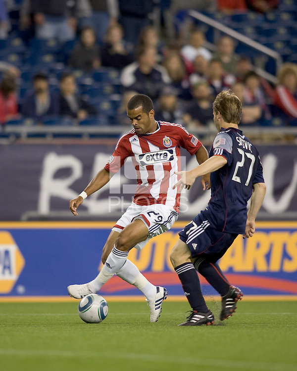 Second half substitute Chivas USA forward Maicon Santos (29) starts to dribble as New England Revolution defender Seth Sinovic (27) closes. Chivas USA defeated the New England Revolution, 4-0, at Gillette Stadium on May 5, 2010.