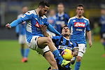 Kostas Manolas of Napoli clears the ball from Lautaro Martinez of Inter during the Coppa Italia match at Giuseppe Meazza, Milan. Picture date: 12th February 2020. Picture credit should read: Jonathan Moscrop/Sportimage