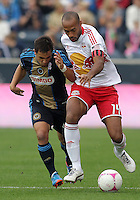 CHESTER, PA - OCTOBER 27, 2012:  Danny Cruz (44) of the Philadelphia Union chases after  Thierry Henry (14) of the New York Red Bulls during an MLS match at PPL Park in Chester, PA. on October 27. Red Bulls won 3-0.