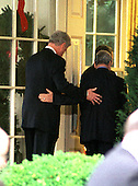 Washington, DC - December 15, 1999 -- United States President Bill Clinton and Farouk al-Sharaa, Foreign Minister of Syria, walk into the Oval Office following their opening statements on the Israeli-Syrian Prece Talks on 15 December, 1999..Credit: Ron Sachs / CNP