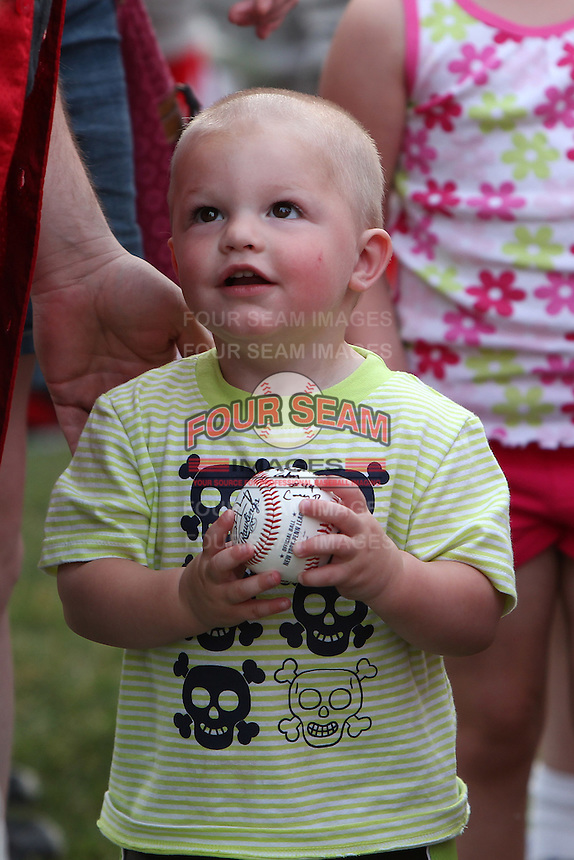Batavia Muckdogs young fan gets autographs from the players during the teams pre-season pep rally at Dwyer Stadium on June 15, 2011 in Batavia, New York.  Photo By Mike Janes/Four Seam Images