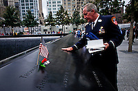 A man visits the 9/11 memorial pool on Wold Trade Center in New York, 21/09/11. The September 11 Memorial & Museum was visited for more than 1 million people since it opened to the public Sept. 12, following the 10th anniversary of the terror attacks in New York, United States. PICTURE TAKEN ON SEPTEMBER 21, 2011  Photo by Eduardo Munoz Alvarez / VIEWpress.