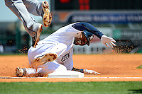 Detroit Tigers outfielder Austin Jackson #14 slides into third during a Spring Training game against the Tampa Bay Rays at Joker Marchant Stadium on March 29, 2013 in Lakeland, Florida.  (Mike Janes/Four Seam Images)
