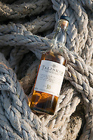 Hebrides, Scotland, May 2010. A ten year old Talisker single malt Scotch Whisky of the Isle of Skye in the suntset on deck. Dutch Tallship Thalassa sails between the islands along the Scotish west coast in search of the quality single malt whisky that is produced by the many distilleries. Photo by Frits Meyst/Adventure4ever.com