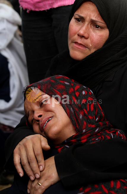Palestinian women cry during the funeral of Tahrer Salman and Mohammed Salman in Beit Lahia, north Gaza, Friday, Nov. 16, 2012. According to relatives, the two members of the Salman family were killed after an Israeli airstrike hit the yard of their house. At least 22 Palestinians, including 12 militants and six children, as well as three Israelis have been killed in three days of fierce exchanges between the Israeli military and Gaza militants. Photo by Ashraf Amra Photo by Ashraf Amra.