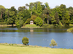 Doric temple and lake, Bowood House and gardens, Calne, Wiltshire, England, UK