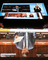 The italian Prime Minister Giuseppe Conte is seen on television, tablet and mobile phone, during his speech at the the lower chamber about the measures taken to counter the spread of the Coronavirus in Italy . <br /> Roma 25/03/2020 <br /> Photo Andrea Staccioli Insidefoto
