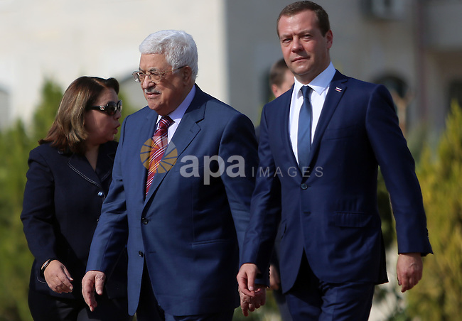 Palestinian President Mahmud Abbas and Russian Prime Minister Dmitry Medvedev arrive for a meeting in the West Bank city of Jericho, on November 11, 2016. Photo by Shadi Hatem