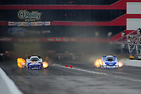 Jun. 18, 2011; Bristol, TN, USA: NHRA funny car driver Jack Beckman (left) alongside Robert Hight during qualifying for the Thunder Valley Nationals at Bristol Dragway. Mandatory Credit: Mark J. Rebilas-
