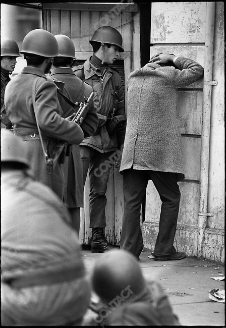 Soldiers stop and search a suspected leftist during the days immediately after Military Coup, Santiago, Chile, September 1973