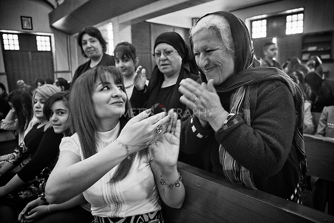 4.4..2015, Kirkuk,Iraq: Najiba inside the church greeting a christian Marya from Kirkuk during the Easter celebration.