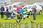 Keel's Bart Murphy tries to hold back Na Gaeil's Diarmuid Herlihy in the Junior Club Championship in Tralee on Sunday.
