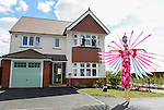Cardiff Blues, Wales and British and Irish Lions player Alex Cuthbert and Cardiff Blues Rhys Williams with one of the Stilt walkers from Vertigo Stilts<br /> <br /> Redrow Homes Official opening of  at Belle View at Mon Bank Newport with Cardiff Blues Players Alex Cuthbert and Rhys Williams - Newport <br /> <br /> &copy; www.sportingwales.com- PLEASE CREDIT IAN COOK