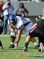 Armwood Hawks lineman Cody Waldrop #54 lines up on a play during the first quarter of the Florida High School Athletic Association 6A Championship Game at Florida's Citrus Bowl on December 17, 2011 in Orlando, Florida.  The score at halftime is Armwood 16 - Miami Central 14.  (Mike Janes/Four Seam Images)
