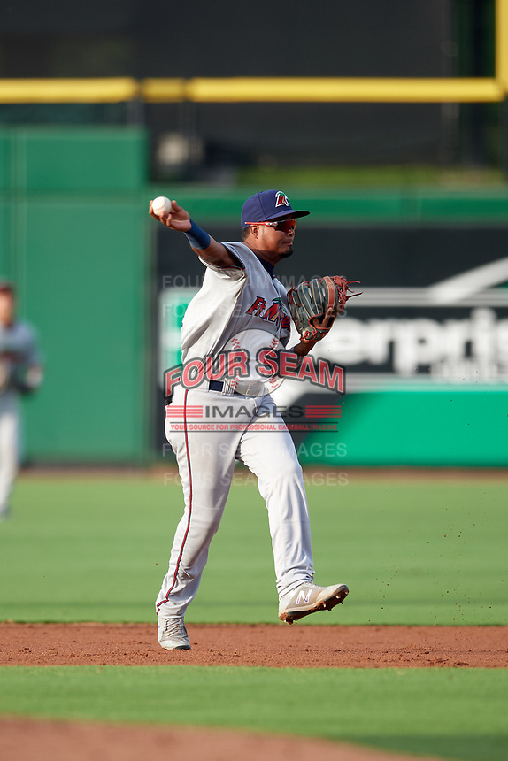 Fort Myers Miracle second baseman Luis Arraez (4) throws to first base during a game against the Clearwater Threshers on May 31, 2018 at Spectrum Field in Clearwater, Florida.  Clearwater defeated Fort Myers 5-1.  (Mike Janes/Four Seam Images)
