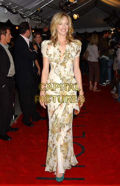 "JUDY GREER.The premiere of ""Elizabethtown"" at the Roy Thompson Hall, part of the 2005 Toronto Film Festival, Toronto, Canada..September 10th, 2005.Photo Credit: Laura Farr/Admedia.full length white green floral print dress.www.capitalpictures.com.sales@capitalpictures.com.© Capital Pictures."