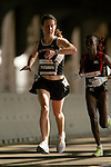 Robyn Friedman (USA) checks her watch as she crosses the 16-mile mark on the Queensboro Bridge from Queens into Manhattan while competing in the ING New York City Marathon in New York, New York on November 4, 2007.  Martin Lel (KEN) won the men's race with a time of 2:09:04  Paula Radcliffe (GBR) won the women's race with a time of 2:23:09.
