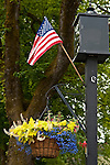 Small town America Port Gamble with light posts and American Flags
