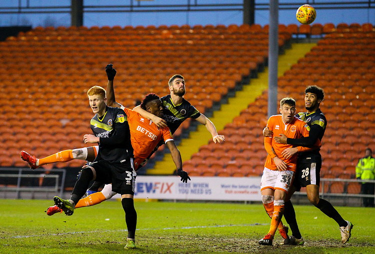 Blackpool's Armand Gnanduillet heads over the bar under pressure from Shrewsbury Town's Luke Waterfall<br /> <br /> Photographer Alex Dodd/CameraSport<br /> <br /> The EFL Sky Bet League One - Blackpool v Shrewsbury Town - Saturday 19 January 2019 - Bloomfield Road - Blackpool<br /> <br /> World Copyright &copy; 2019 CameraSport. All rights reserved. 43 Linden Ave. Countesthorpe. Leicester. England. LE8 5PG - Tel: +44 (0) 116 277 4147 - admin@camerasport.com - www.camerasport.com