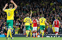 Francis Coquelin of Arsenal protests a yellow card during the Carabao Cup match between Arsenal and Norwich City at the Emirates Stadium, London, England on 24 October 2017. Photo by Carlton Myrie.