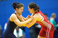 11 MAY 2014 - SHEFFIELD, GBR - Olga Butkevych (left) attempts to overpower Chloe Spiteri during their women's 55kg category freestyle match at the British 2014 Senior Wrestling Championships at EIS in Sheffield, Great Britain (PHOTO COPYRIGHT © 2014 NIGEL FARROW, ALL RIGHTS RESERVED)