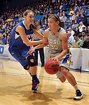 SIOUX FALLS, SD - MARCH 11:  Ashley Eide #30 of South Dakota State drives past Rebecca Bruner #34 of IPFW during their semifinal game at the 2013 Summit League Basketball Championships Monday at the SIoux Falls Arena.  (Photo by Dick Carlson/Inertia)