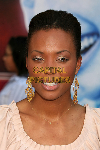 "AISHA TYLER.Los Angeles Premiere of ""The Santa Clause 3: The Escape Clause"" at the El Capitan Theatre, Hollywood, California, USA..October 29th, 2006.Ref: ADM/BP.headshot portrait gold earrings.www.capitalpictures.com.sales@capitalpictures.com.©Byron Purvis/AdMedia/Capital Pictures."