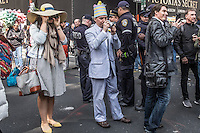 People take pictures as people attend the annual easter parade in Manhattan, New York, 03.27.2016. This annual tradition has been taking place in New York City for over 100 years, Photo by VIEWpress/Maite H. Mateo.