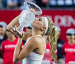 Dayana Yastremska of Ukraine poses for photo with trophy after winning the singles final match against Wang Qiang of China at the WTA Prudential Hong Kong Tennis Open 2018 at the Victoria Park Tennis Stadium on 14 October 2018 in Hong Kong, Hong Kong.