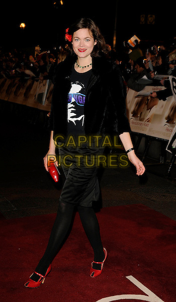 """JASMINE GUINNESS.The UK Film Premiere of """"Revolutionary Road"""" at the Odeon Leicester Square, London, England..January 18th 2009.full length black skirt top fur jacket tights red clutch bag peep toe shoes mary janes .CAP/CAN.©Can Nguyen/Capital Pictures."""