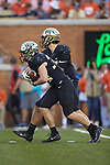 Wake Forest Demon Deacons running back Will Drawdy (34) takes the hand-off from quarterback Matthew Considine (18) during second half action against the Clemson Tigers at BB&T Field on October 6, 2018 in Winston-Salem, North Carolina. the Tigers defeated the Demon Deacons 63-3. (Brian Westerholt/Sports On Film)