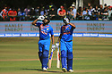 India's Shikhar Dhawan and Rohit Sharma call for drinks as high tematures toast players during a T20 match between Ireland and India at the Malahide cricket club in Dublin on June 27, 2018. Photo/Paul McErlane