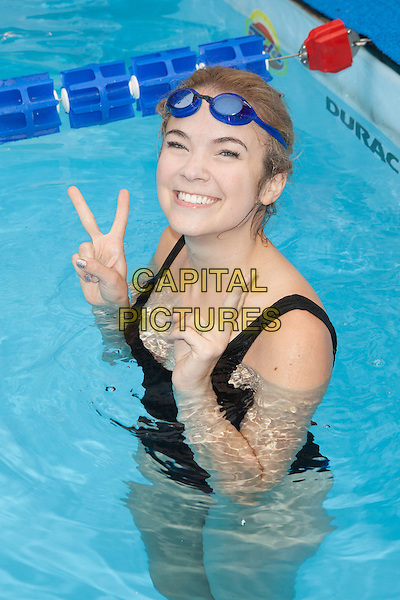Lenay Dunn  <br /> attends the 'Swim for Relief' Benefiting Hurricane Sandy Recovery at Herald Square, New York City, NY., USA.<br /> October 9th, 2013 <br /> full length water bathing suit swimsuit black goggles hand v peace sign <br /> CAP/MPI/COR<br /> &copy;Corredor99/ MediaPunch/Capital Pictures