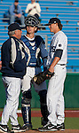February 22, 2013: Nevada Wolf Pack head coach Gary Powers talks with his pitcher Bardey Shipley in a game against the Northern Illinois Huskies played at Peccole Park on Friday afternoon in Reno, Nevada.