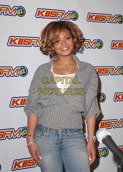 CHRISTINA MILIAN.102.7Õs KIIS-FMÕs 4th Annual Jingle Ball held at The Pond of Anaheim in Anaheim, California  .December 4th, 2004.half length, grey, gray sweater.www.capitalpictures.com.sales@capitalpictures.com.Supplied by Capital Pictures