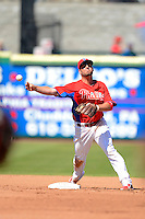 Philadelphia Phillies second baseman Kevin Frandsen #28 attempts to turn a double play during a Spring Training game against the Dominican Republic at Bright House Field on March 5, 2013 in Clearwater, Florida.  The Dominican defeated Philadelphia 15-2.  (Mike Janes/Four Seam Images)