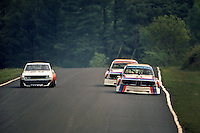 Sam Posey drives his BMW 3.0 CSL ahead of teammate Hans Stuck as they pass a slower car during the Schaefer 350 IMSA Camel GT race at Lime Rock Park near Lakeville, Connecticut, on May 26, 1975. (Photo by Bob Harmeyer)